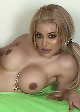 A Beautiful Blonde with Big Plastic Titties masturbating in bed