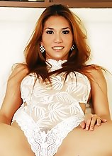 Gorgeous TS Sapphire Young in white lace sporting a great erection