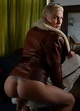 Smoking hot Danni posing in jacket