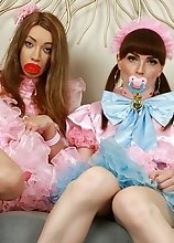 Natalie Mars and Sasha both put on these crazy cute pink & blue outfits in this one and have some fun with buttplugs and a massive dildo! Watch th