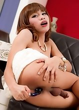 Teen ladyboy Firsty in moms pretty pearls and high heels. A blue glass toy pushes into Firsty's ass. She strokes her cock and cums a tasty load.